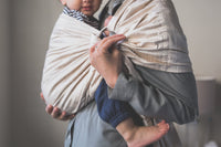 Woman toddler wearing her son in a Zarinah ring sling