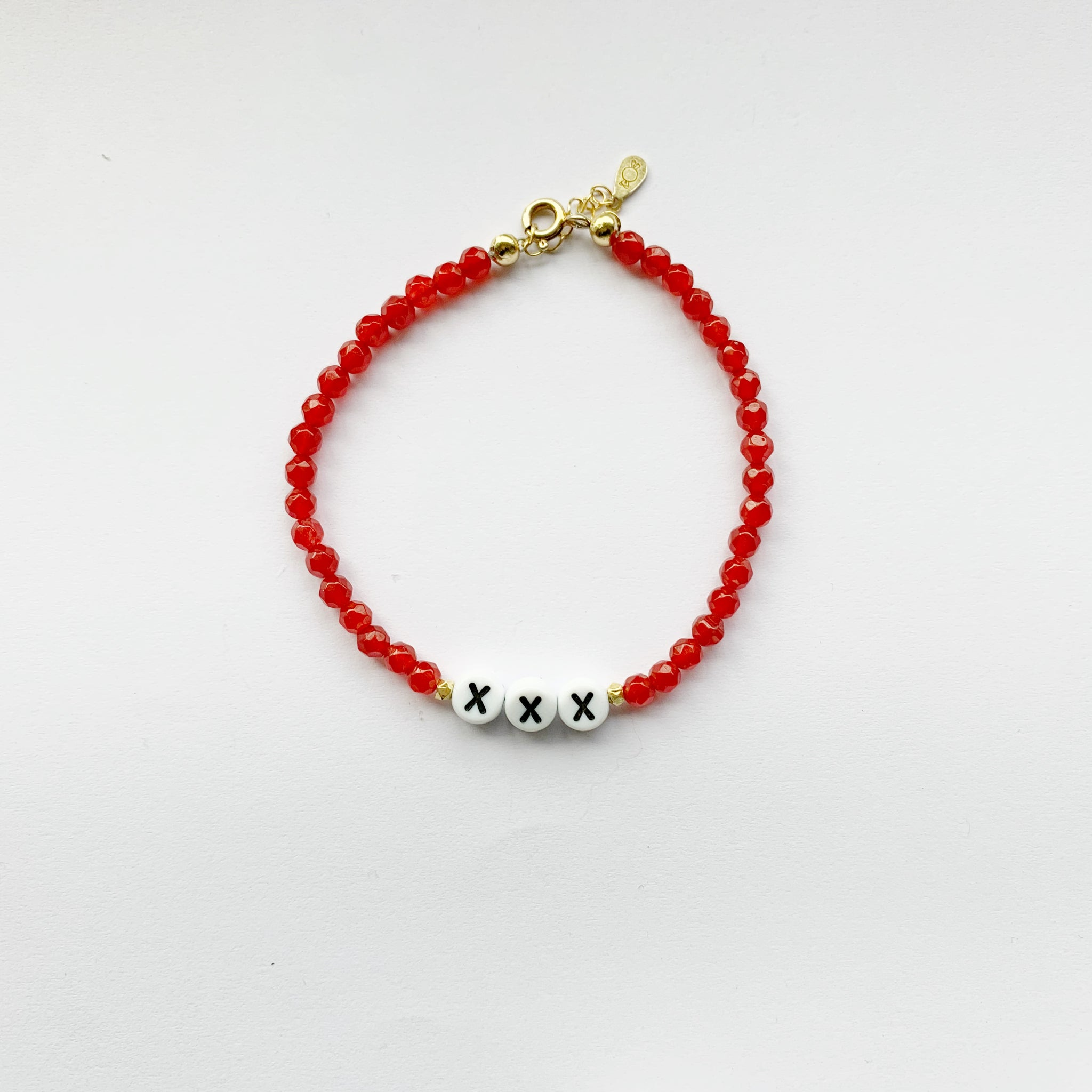 Say it out Loud Bracelet  Red tinted beads