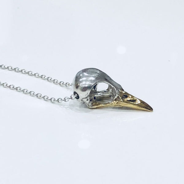 Gold bird skull necklace