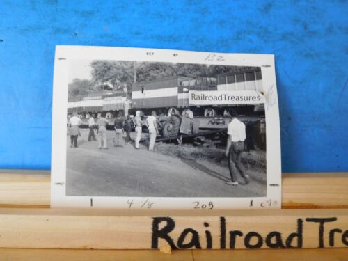Photo Circus cars on railroad flat cars. Lots of people walking around people