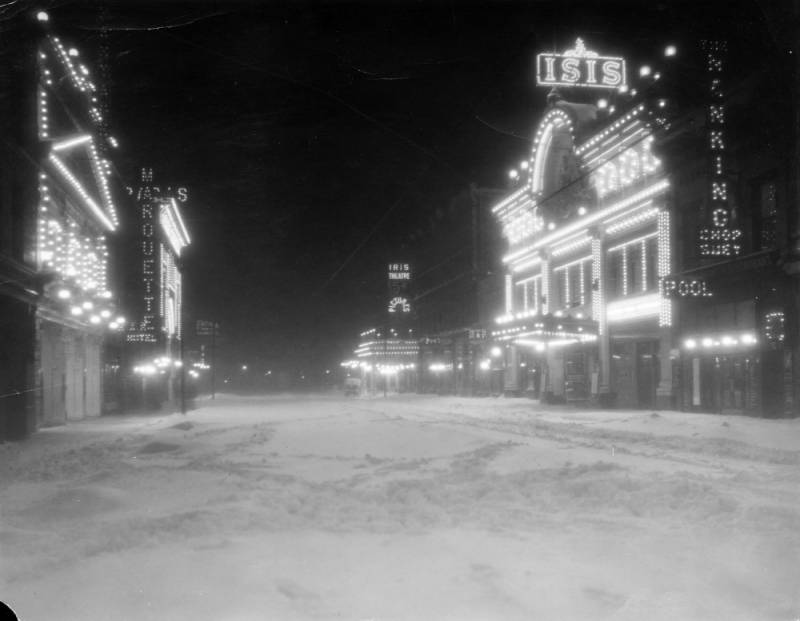 Black & White Photo of a Snow covered Curtis Street Denver with Theater Lights circa 1913