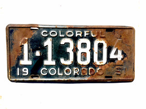 1951 Colorado License Plate White on Black 113804