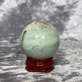 Caribbean Calcite Sphere 40mm Crystal Inclusions.