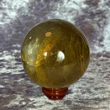Golden Healer Quartz Sphere 525g Crystal Inclusions.