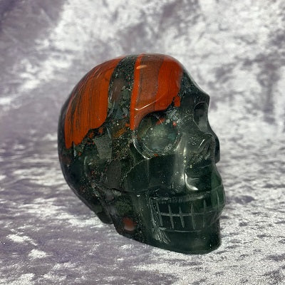 African Bloodstone Skull 705g Crystal Inclusions.