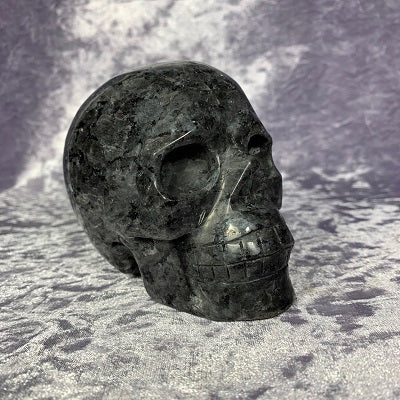 Larvikite Skull 930g Crystal Inclusions.