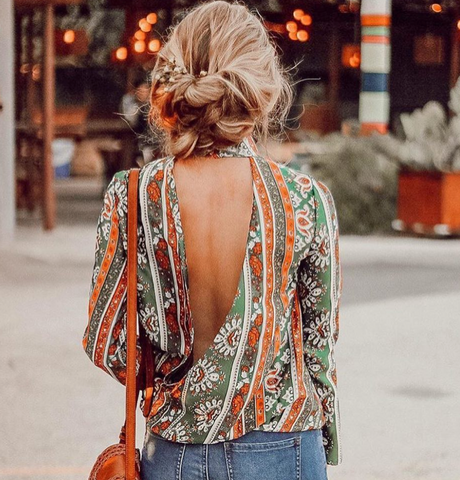 open back green and orange paisley blouse with updo bun
