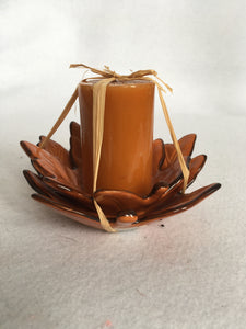 Harvest Candle Resting on Two Layered Leaves