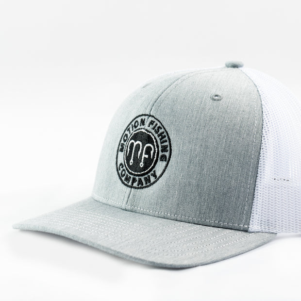 Grey front white mesh richardson 112 snapback hat with a black Motion Fishing logo