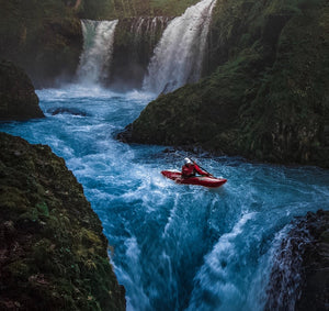 Picture of man in a canoe rowing in the dangerous rapids. Subject matter is the greatest athletes of all time