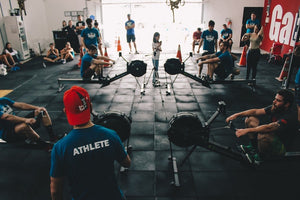peak performance on competition day image of cross fit athletes on concept 2 rowers