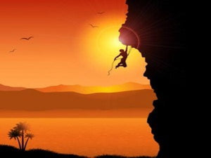 moral courage image of a man rock climbing and hanging on with one arm
