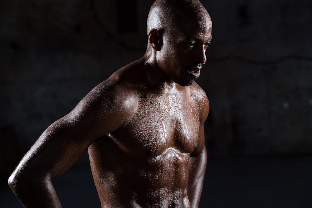 Meditation for athletes: founder of Souletics with  shirt off looking muscular and sweat dripping from him