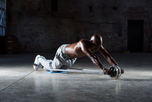 man doing an ab roller workout