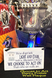 "Show your love of Harry Potter with this plaque hanging in your home or office as the perfect Harry Potter gift idea or fandom love.   Plaque has white  and grey background with a graphic of Dumbledore in the top right corner.  Plaque reads ""We've all got both light and dark inside of us. What matters is the part we choose to act on. That's who we really are."""