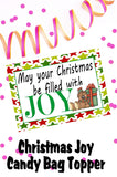 Wish your family and friends a Happy Christmas with this printable to and from tag in the form of a bag topper.  Add some yummy Almond Joys to a bag and top with this bag topper, then add a to and from greeting on the back.  Tie to a present and give as a sweet treat.