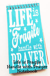 Help yourself through the tough times of life by handling life's storms with prayer.  Life is fragile, handle with prayer.  This notebook is perfect as a gratitude journal or as a reminder notebook for your purse or desk.