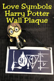 "Show your love of the world of Harry Potter and don't hide that love with this fun Harry Potter wall plaque perfect for your home or office.  Plaque has a navy blue background.  Inside border is the world ""Love"" with fun Harry Potter symbols from the books and movies.  You'll find brooms and wands, the sorting hat, the goblet of fire, the 9 3/4 symbol, the snitch, a lightning bolt, and the Deathly Hollows symbol."