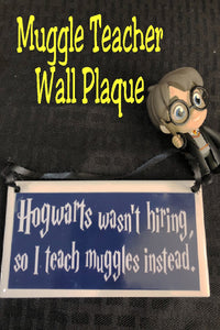 "Your favorite  ""Potterhead"" teacher will love this wall plaque as a gift anytime of year.  Plaque has a navy blue background with the wording ""Hogwarts wasn't hiring so I teach muggles instead"" in a fun Harry Potter style font."