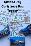 Wish your family and friends a joyful Christmas with this printable bag topper.  Add some yummy Almond Joys to a bag and top with this bag topper. This would make a great to and from greeting Tag by adding your info on the back.  Tie to a present and give as a sweet treat.