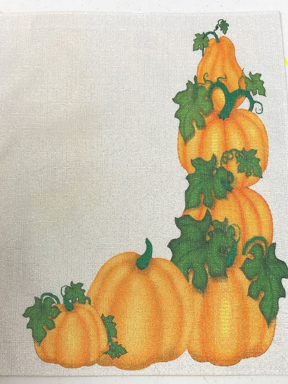 Decorate your table with these beautiful pumpkin pieces.  They make the perfect addition to a Thanksgiving dinner party, a fall dinner party, or a Halloween party with their cute stacked pumpkins on Place mats and napkins.