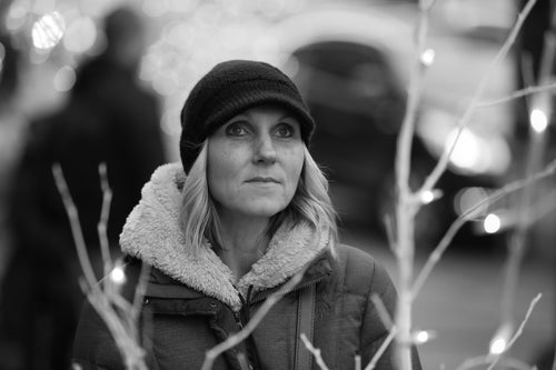 Black and White Image of Tracee wearing a winter hat and coat