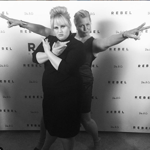 Emme and Rebel Wilson posing like Charlies Angels at an event