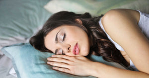 Close up photo of woman sleeping on a pillow