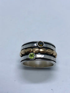 Smadar design ring with tourmaline and peridot stones on spinner