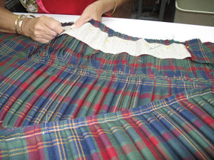 An entirely hand-stitched custom 8 yard kilt made at The Scottish Company, Toronto