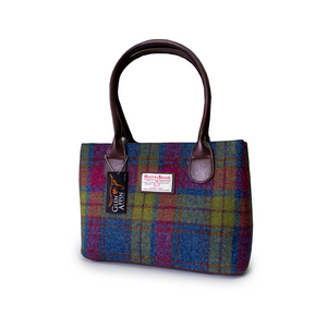 Harris Tweed is world renowned as the only hand-woven commercial cloth and is governed very carefully with their licences.  To have the Harris Tweed label is a privillage.  This handbag is available online and in-store from The Scottish Company, Toronto,