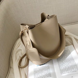 wide strap buckets bag