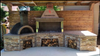 Outdoor Stone Kitchen With Large Firebrick Pizza Oven and Large Rotisserie bbq