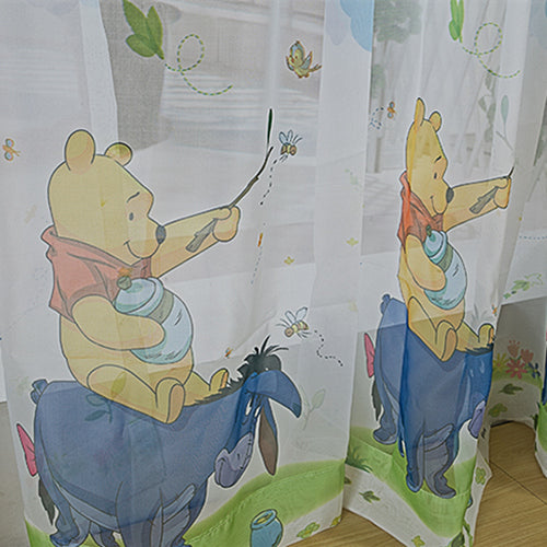 Close up of Disney Pooh and Tiger Yellow Tulle Window Curtains for Kids Room