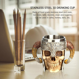 Stainless Steel 3D Skull Coffee Drinking Cup shown next to a pencil stand on a computer table