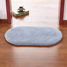 Modern oval rug with soft and plush microfiber texture and anti-slip back