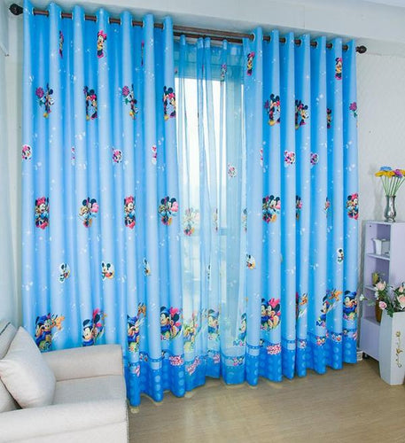 Blue Mickey Mouse Curtain Shown Over a room window and Tulle backing.