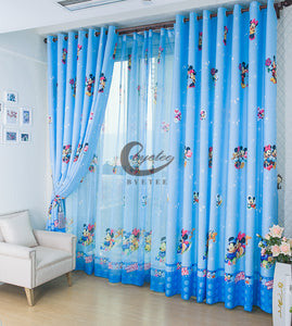Blue Minnie and Mickey Mouse Tulle Shown on top of Window and Thick curtain on Top of Tulle.