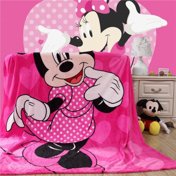 Soft Plush Minnie Mouse blanket shown spread on chair in a kid's room