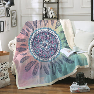 Bohemian Manadal and Dreamcatcher Design Fusion Sherpa Fleece Blanket shown on a sofa in a living room