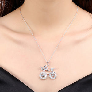 Closeup on a woman neck who is wearing a White Gold-Plated Bicycle Pendant Necklace.