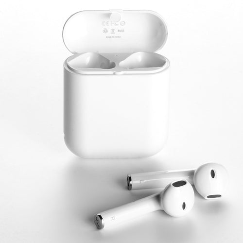 White langsdom wireless headphones and the charging case shown separately