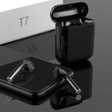 Black langsdom wireless headphones with a black charging case kept on a black reflective surface