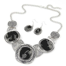 Black rhinestone necklace with 3 large stones and 2 hook earrings