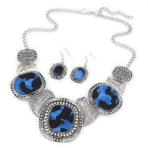 Blue rhinestone necklace with 3 large stones and 2 hook earrings
