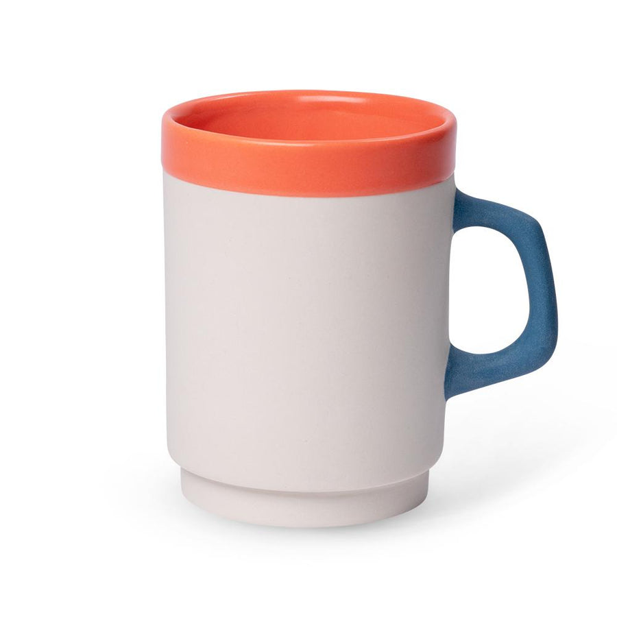 a white diner mug with an orange rim and blue handle