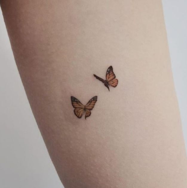 5cb5bb8a4 12 Delicate Butterfly Tattoos and their Meanings - easy.ink™