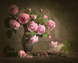 Camellia flowers in a vase at dusk