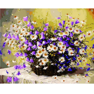 White daisies with purple flowers in vase