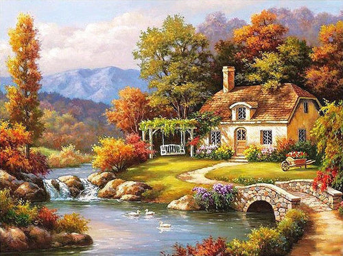 Cottage by the river at day